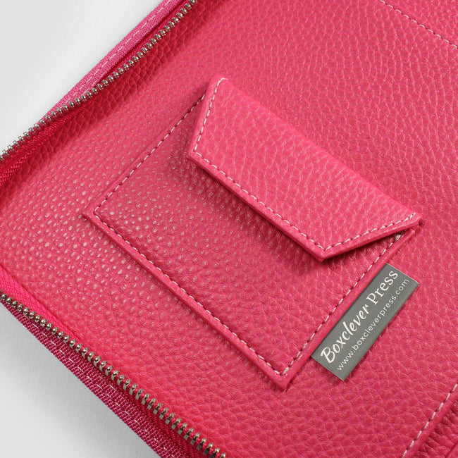Close up of velcro pocket in pink diary cover with Boxclever Press label