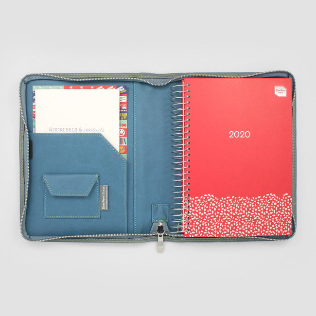 Blue diary cover with pocket on the left side. On the right hand side a Family Life Book diary with red cover
