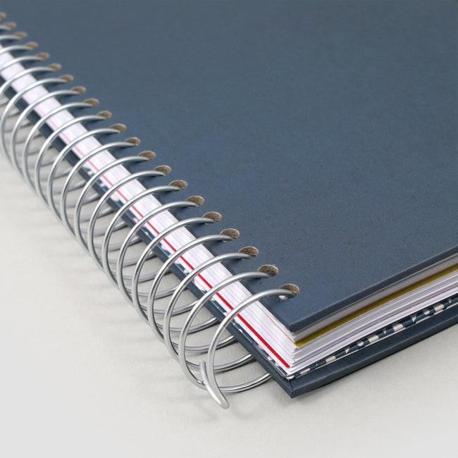 Silver spiral binding with blue cover on A5 life planner diary