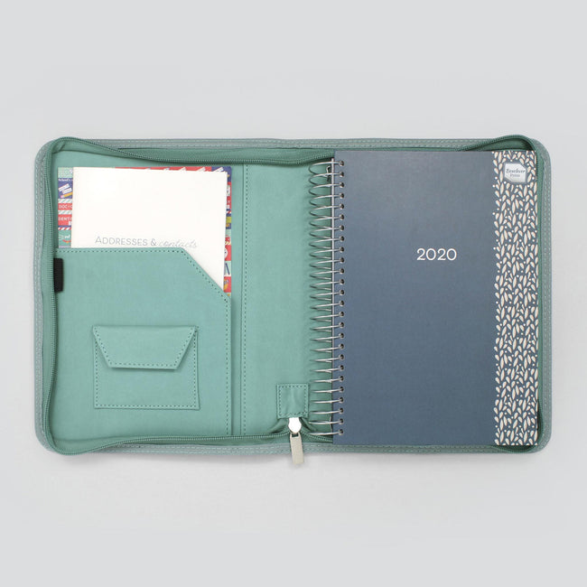 Decorative 2020 blue faux leather diary organiser sat in light blue cover with paperwork pocket and velcro pocket
