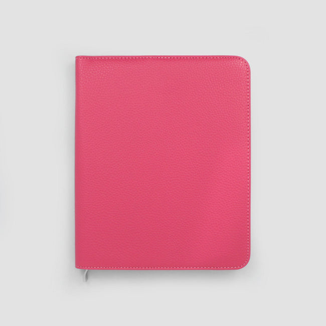 Bright raspberry pink A5 Life Book diary cover with rounded corners and contrasting stitching on grey background