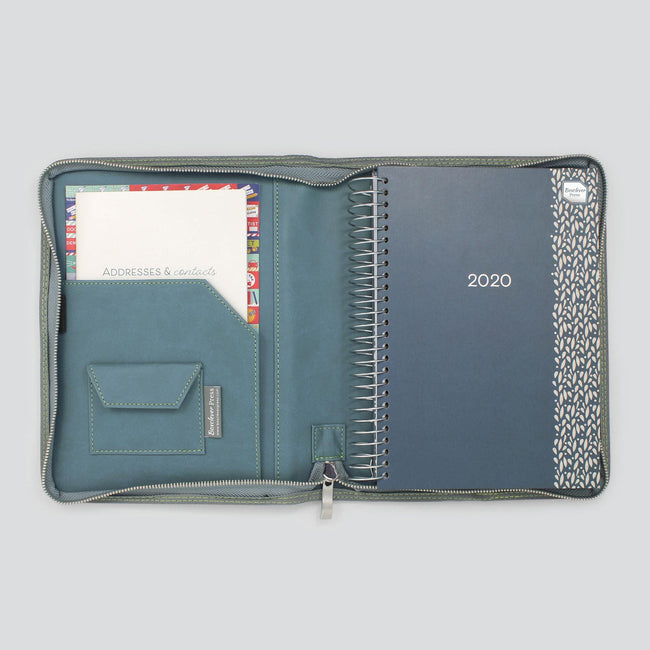 Life Book diary organiser in zip around cover with paperwork pocket and velcro pocket. Open on desk layout.