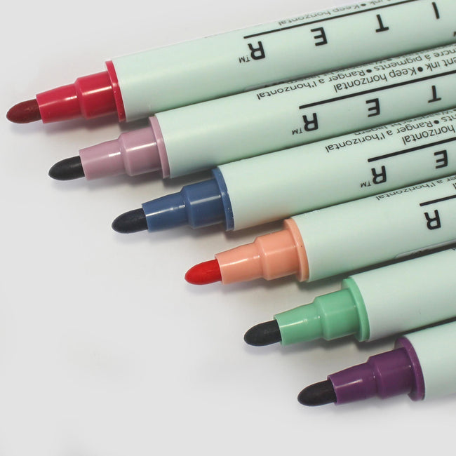 PEN_ZIG_Gallery_2 Six Kuretake Zig double ended writing pens showing felt tip nib colours including purple, sage, coral, denim
