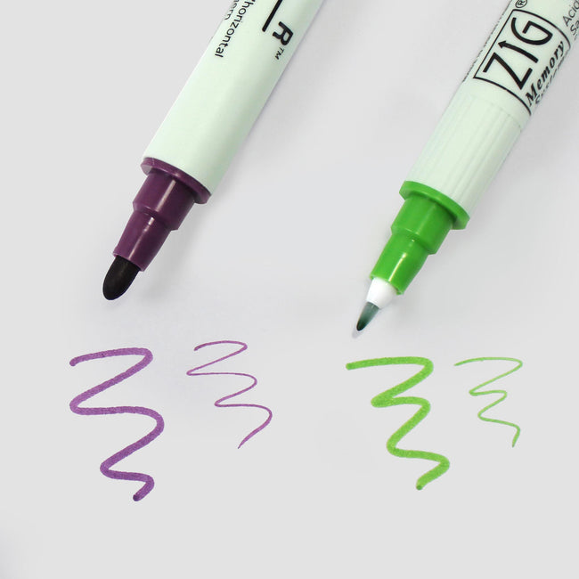 PEN_ZIG_Gallery_4 Purple and green kuretake Zig Writer pens with thick and thin nib beside scribbles