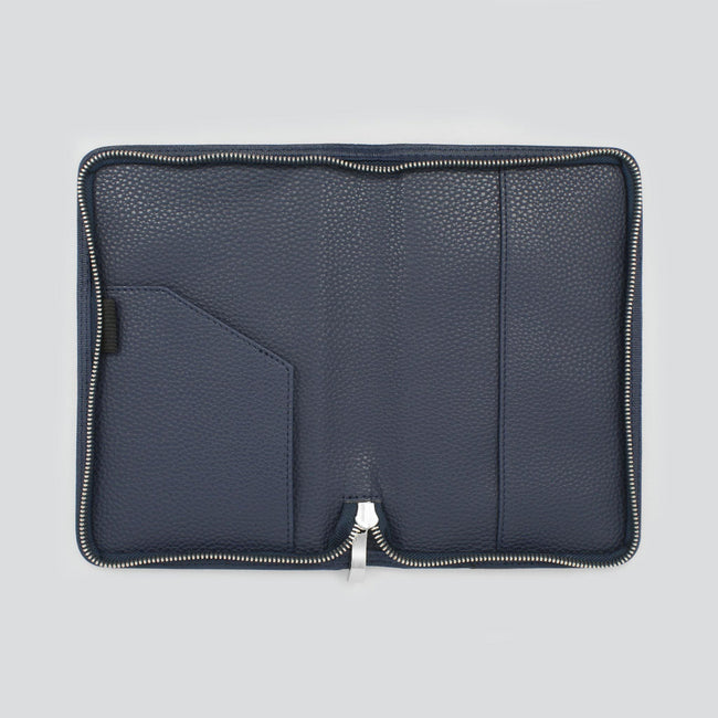Open dark blue diary cover with pockets and silver zip