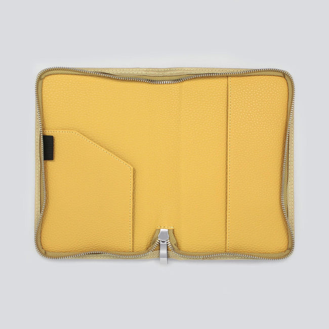 Slimline diary cover in mustard yellow with pocket on the left and right side
