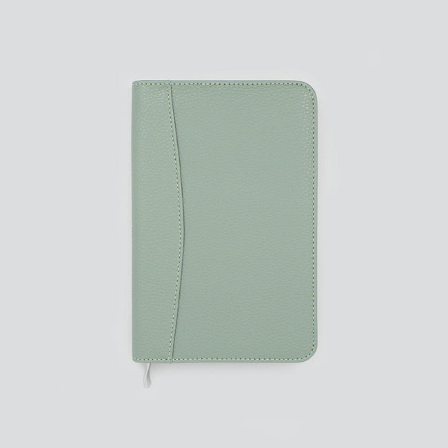 Light sage green diary and organiser cover with textured finish on pale grey background