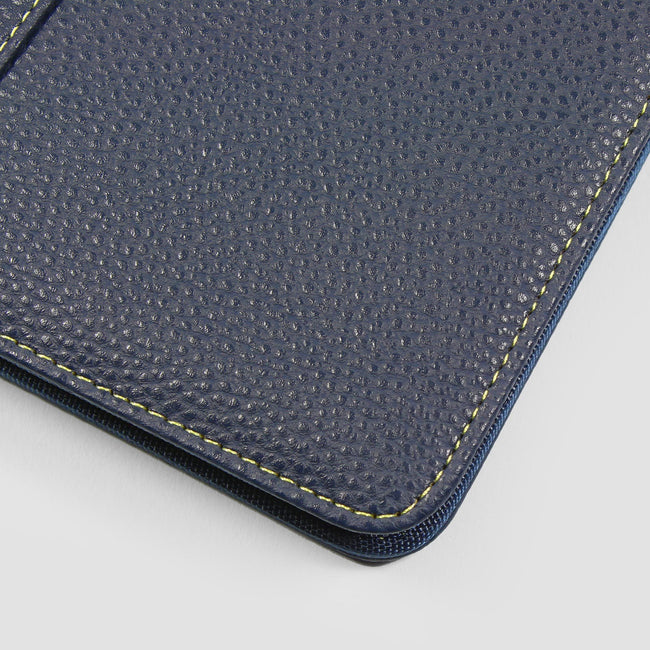 Slimline diary cover in dark midnight blue close up to show stitching on grey background