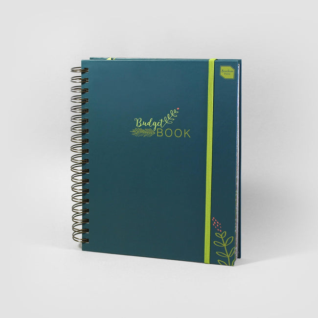 Family accounts book with dark green cover and floral decoration on grey background.