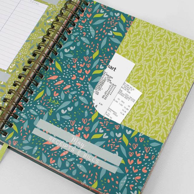 Finance book ideal if you are self employed showing the receipt page with receipts in the floral pocket