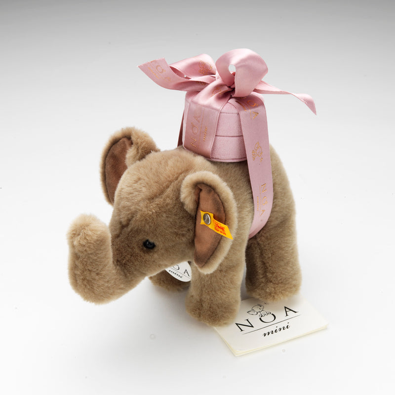 A plush Steiff elephant toy is gifted with each NOA mini elephant pendant in white or back gold
