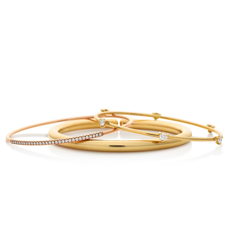 d'Oro gold diamond bangles with flexible gold technology