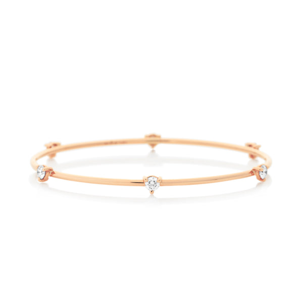 d'Oro 18 karat rose gold diamond drop bangle from NOA fine jewellery