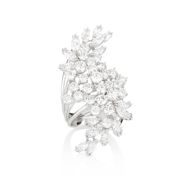 4 white gold rings fan open to hold a stunning cluster of round and marquise-cut diamonds in the NOA Icons diamond ring