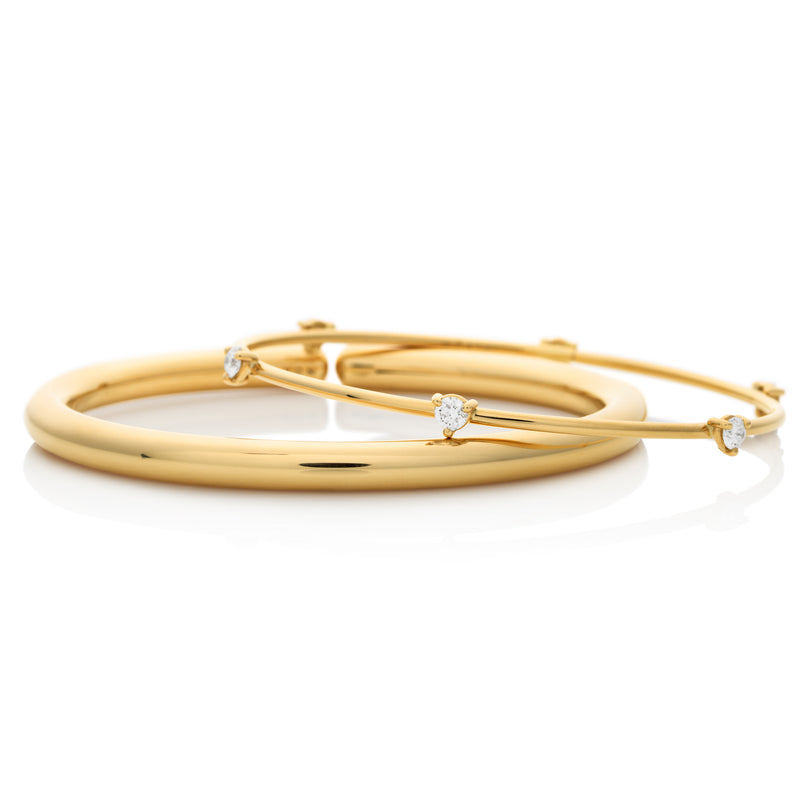 d'Oro 18 karat gold bangles with flexible gold technology from NOA fine jewellery