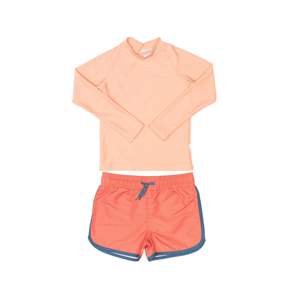 Peach Rashie and Red Swim Shorts