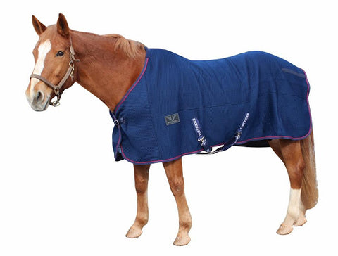 The TuffRider Thermo Manager Stable Sheet with Piping is ideal for horses kept stabled in cold climates, or any horse that is clipped in the winter.