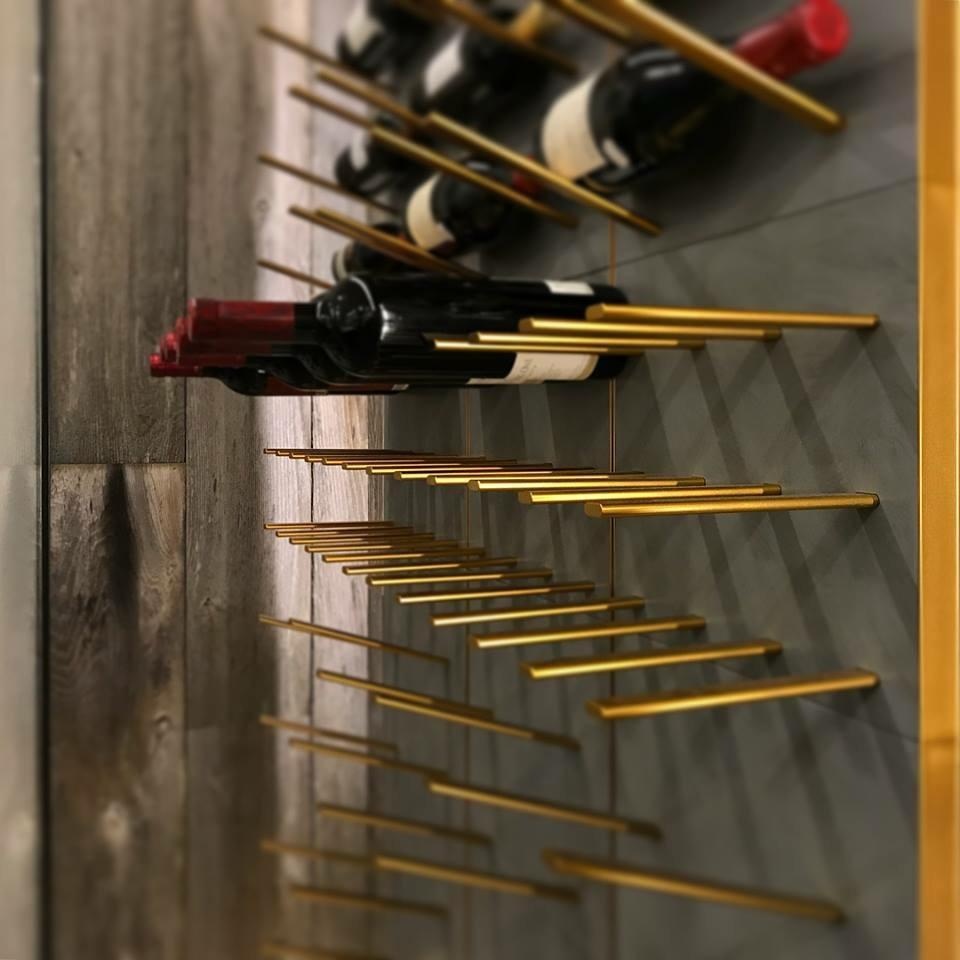 concrete wine rack with brass hardware