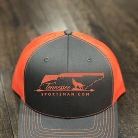 Our neon orange & black trucker hat with matching embroidery.