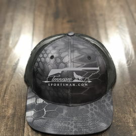 Our black camo trucker hat with grey embroidery.