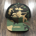 Our retro camo trucker hat with matching embroidery.