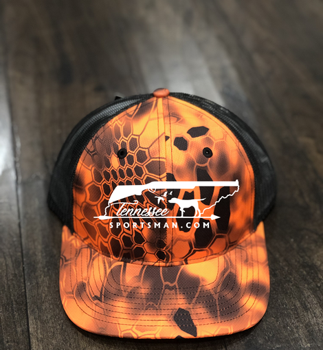 Our black camo trucker hat with neon orange accents and embroidery.