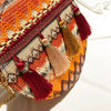 Handcrafted tassel round bag