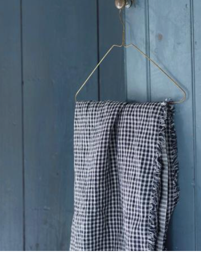 Brass Coat Hanger. These Fog Linen hand-wrought brass hangers are perfectly suited to lighter items like shirts and dresses. Light-weight, slim profile and minimalistic.