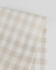 Gingham Linen Napkin - Bone. A fun gingham linen in Bone, this fabric is made from European Flax certified yarn creating a lovely earthy feel, with subtle, naturally occurring slubs throughout. The yarn-dyed pattern is made up of a white and Paprika striped warp and weft which combine to create a gingham style rectangular check.