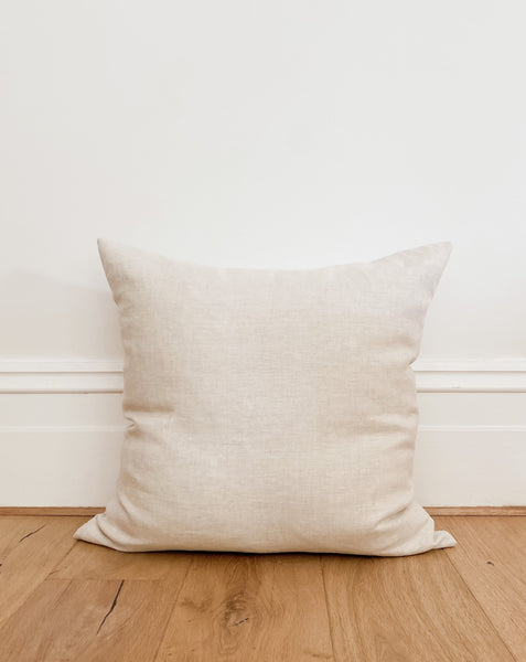 Linen Cushion Cover - Natural. A beautiful and comfortable cushion made from heavy weight pure linen. A classic plain weave linen in a textured natural colourway. A natural-coloured weft and ivory coloured warp gives this heavyweight linen a chambray feel.