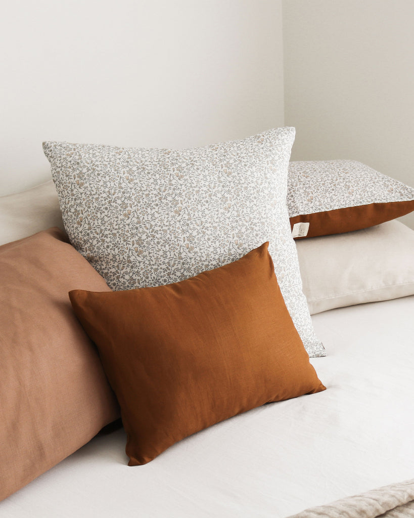 Oski and Lottie Autumn Floral Square Linen Cushion 50 x 50cm. Square linen cushion featuring a ditsy floral print front and an ochre Oeko-Tex certified heavy weight linen reverse.  Our printed Belgian linens are created in Melbourne using non toxic, solvent free, water based pigment inks.