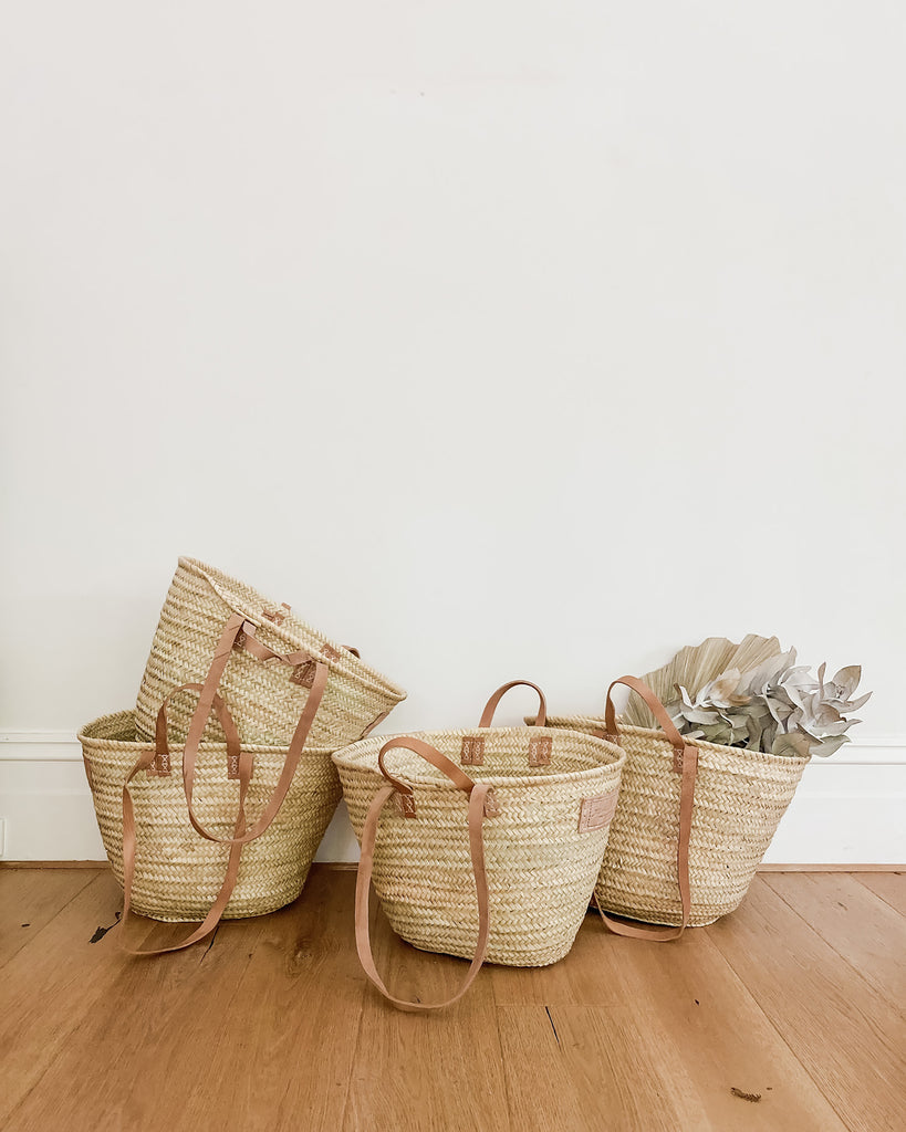 Double Marketeer Basket. These beautiful handmade market baskets are perfect for trips to the grocery store, farmers market, beach or work and make terrific storage baskets. This traditional French market basket has been hand woven, using traditional techniques, and features double handles in naturally oiled brown leather.