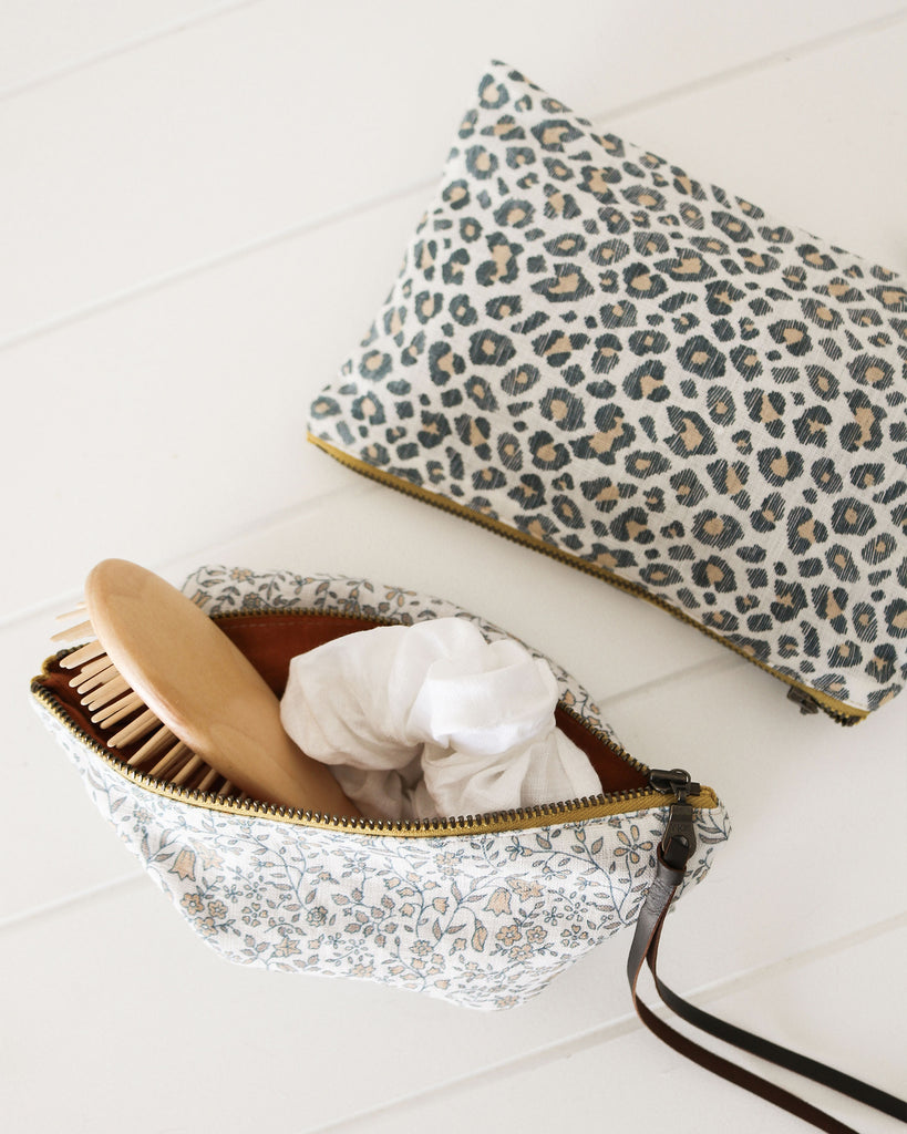 Ocelot Leopard Cosmetic Pouch - Oski and Lottie. The perfect accessory to hold all your essentials. The Ocelot Pouch can be used as a cosmetic bag, as a handbag organiser or as a cute clutch.  Leopard print on Belgian linen, lined with medium weight linen fabric.  Designed and made in Melbourne, by skilled women who are passionate about creating timeless accessories.