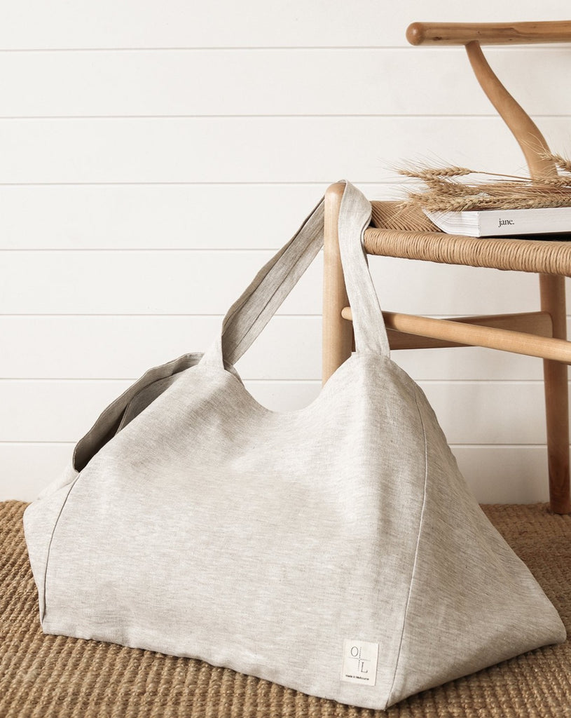 Large Essential Tote - Oatmeal. An oversized version of our Essential Tote, this is the perfect everyday carry-all bag or weekender made from 100% linen with a large interior pocket 35 x 27cm, designed to fit your laptop.  Inside, the bag is fitted with a printed Belgian linen detail with antique brass D ring to secure your keys. Perfect for a weekend getaway, a day at the beach, to take to the office or farmers markets.