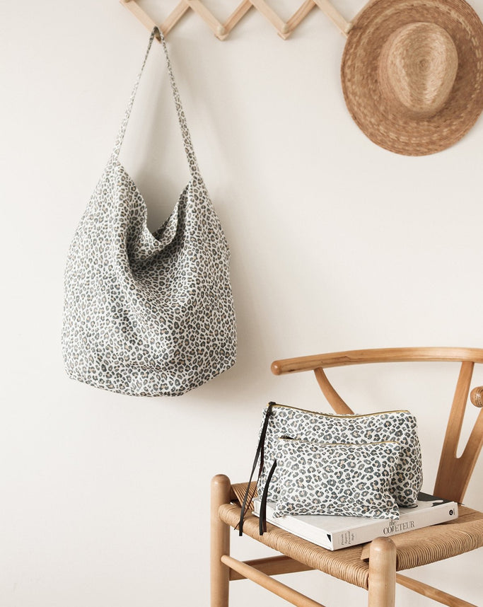 Beautiful and functional. Our Bucket Totes are designed for daily use, trips to the farmers market, travelling, yogis, beach days and mums with bubs.  Our Ocelot Bucket Tote is made from Leopard Print heavyweight linen fabric with a Steel coloured inner lining.  Our Bucket totes are fully lined with printed Belgian linen and reversible.