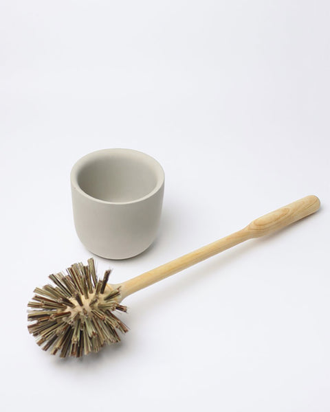 Birch Toilet Brush with Concrete Cup. This beautifully crafted birch toilet brush sits in a light grey concrete cup, which is moulded by hand in a small workshop outside Stockholm, Sweden.
