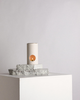 Designed with a minimal aesthetic, the Limestone Synergy Oil Burner features a brass dish and tea light holder. The designer oil burner is carved from a solid piece of stone and includes an Essential Oil & Australian beeswax candle.