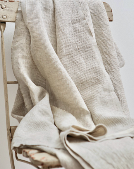 Washed Waffle Linen Throw - Oatmeal. This gorgeous linen bed cover is perfect for use in your living room, bedroom, on picnics and at the beach. Inspired by antique linen, the subtle waffle texture feels is light and comforting against the skin.