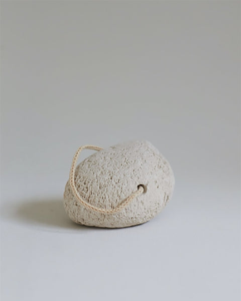 Natural Pumice Stone. This high quality natural pumice stone, effectively removes dry and rough skin from the soles of your feet, knees and elbows. Features a cotton rope for easy storage when not in use.