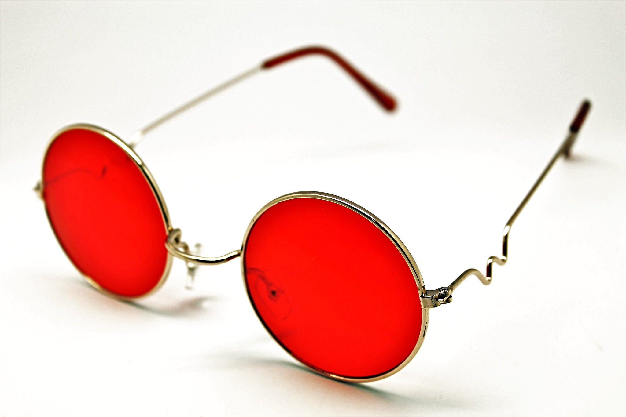 a0b0a71d086 Lennon style sunglasses with red lenses and gold frames