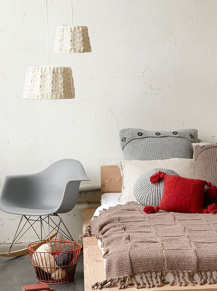 knitted pillows, blanket, headboard