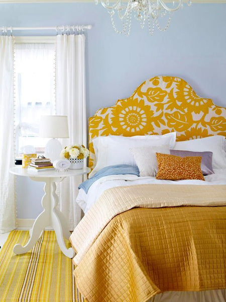 bed, with yellow throw and pillows