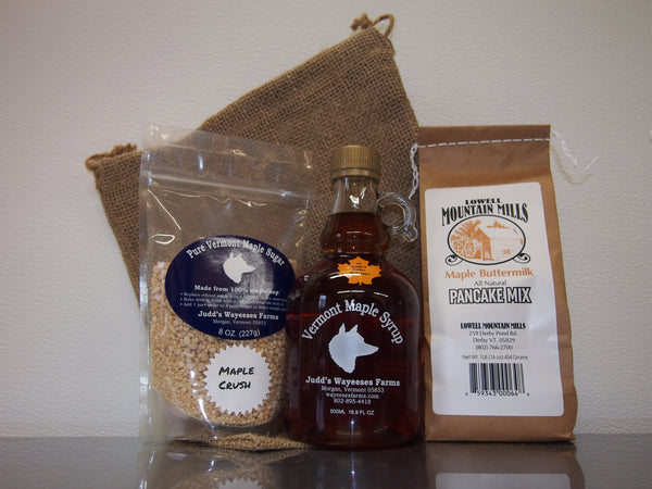 photo of a bag of maple crush, a half liter of Amber maple syrup and a one pound bag of pancake mix