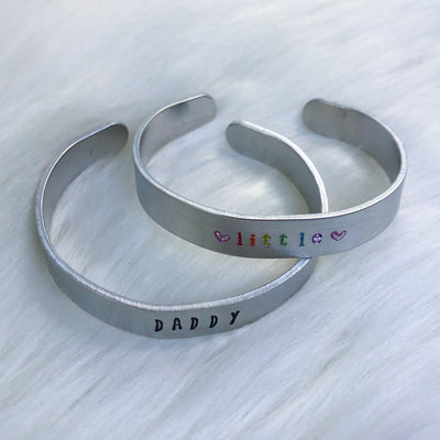 Submissive Titles Aluminum Cuff Bracelet