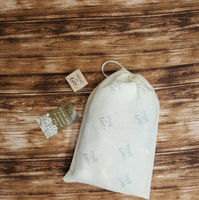 * all clothing is gift packaged in these handmade, re-usable muslin bags *