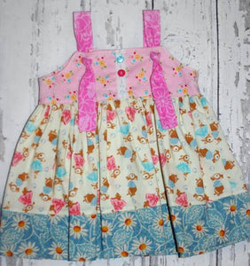 Bunnies and Flowers on this cute sleeveless sun dress in size 0/3 months *