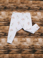 Load image into Gallery viewer, Sweet little leggings for baby in sizes Newborn, 3 mo, & 6/9 mo. Cute baby circus elephants balancing on balls. Nice Baby Shower Gift.