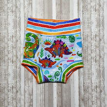 Load image into Gallery viewer, Cute little Bummies, diaper covers for infants and toddlers in sizes 9/12 months through 18/24 months.  Brightly colored Dinosaurs.
