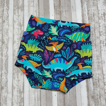 Load image into Gallery viewer, Cute little Bummies, diaper covers for infants and toddlers in sizes 0/3 months through 18/24 months.  Bright Dinosaurs.