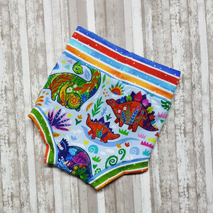 Cute little Bummies, diaper covers for infants and toddlers in sizes 9/12 months through 18/24 months.  Brightly colored Dinosaurs.